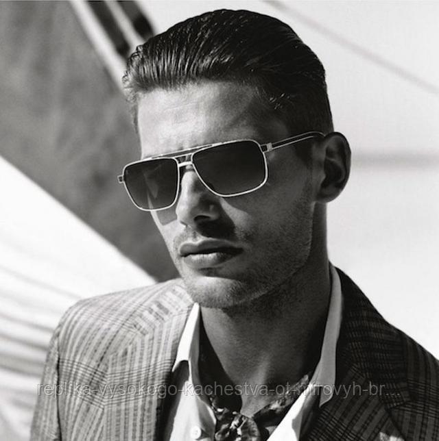 Мужчина в солнцезащитных очках Луи Виттон