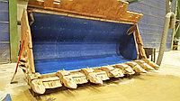 Футеровочный материал DYNO FLO для самосвалов, экскаваторов, вагонов и промышленных объектов