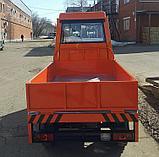 Электротележки грузоподъемностью 2 тонны со стеклопластиковой кабиной, с пневматическими шинами, фото 5