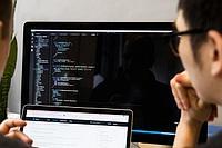 developer_reviewing_javascript_925x.jpg
