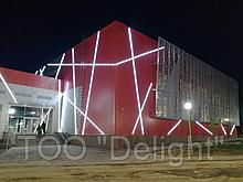 Устройство освещения фасада здания спортивного комплекса