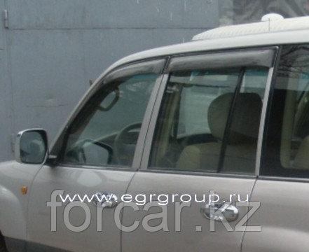 Дефлекторы боковых окон EGR 4 части карбон Toyota Land Cruiser 100 1998-2007