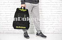 Рюкзак с боковыми карманами и ремешками спортивный черный с салатовой надписью и логотипом