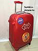 Средний пластиковый дорожный чемодан на 4-х колесах Ambassador.Высота 67 см, длина 42 см, ширина 26 см.
