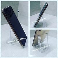Подставка пластиковая под телефоны