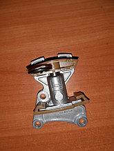 Натяжитель цепи ГРМ .VW Passat B6