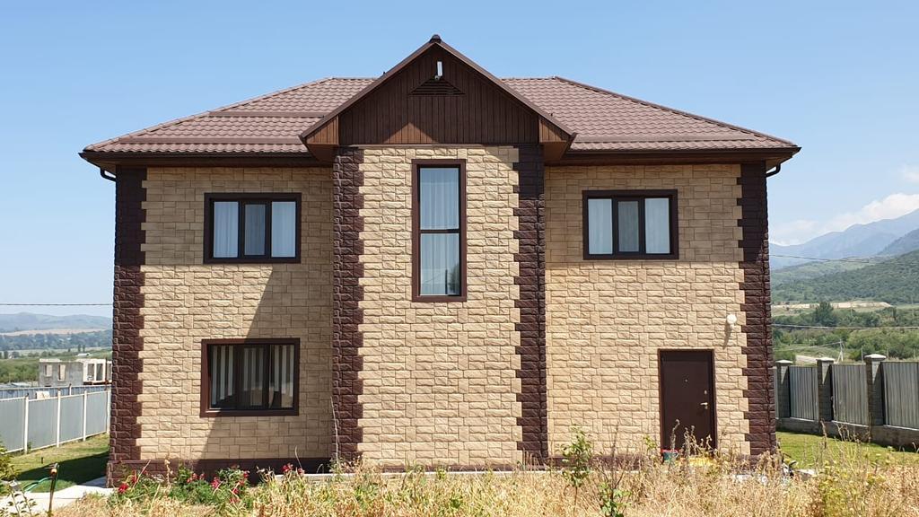 Частный жилой дом, облицованный фасадными панелями Fine Ber