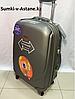 Medium plastic travel suitcase on 4 wheels.Height 69 cm, length 39 cm, width 25 cm.
