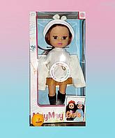 Кукла в красивой осенней одежде.
