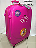 Large plastic 4 wheels travel  suitcase Ambassador. Height 79 cm, length 49 cm, width 29 cm.