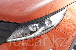 Накладки на передние фары (реснички) KIA Sportage 2010-2013