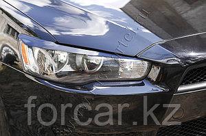 Накладки на передние фары  Mitsubishi Lancer X 2011-
