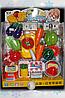 Игрушечный набор посуды с овощами.