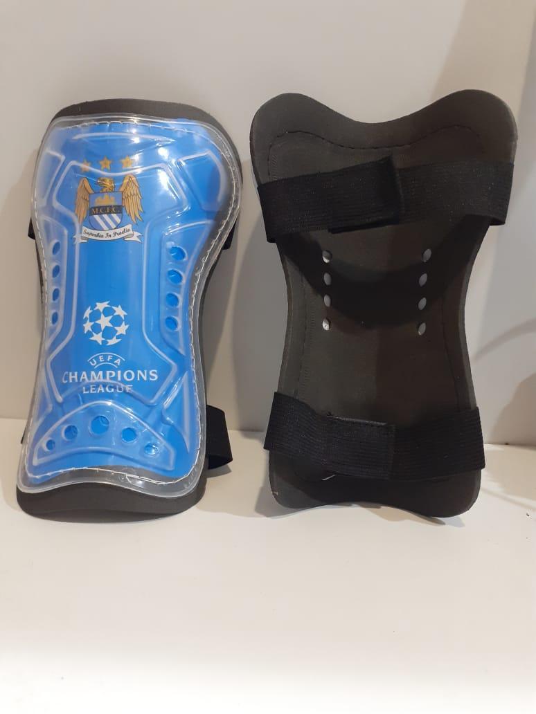 Футбольные щитки Manchester City  (цвет голубой)
