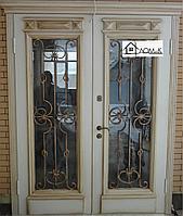 Дверь эксклюзивная со стеклом и ковкой