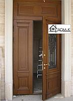 Дверь двухстворчатая со стеклом и ковкой