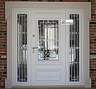 Дверь металлическая с ковкой и стеклом на заказ в Алматы