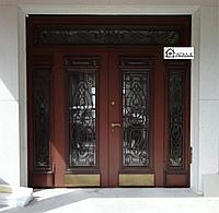 Дверь металлическая  со стеклопакетом и ковкой