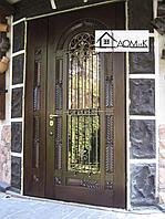 Двери металлические с ковкой и стеклом в Алматы