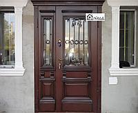 Входная дверь с кованными элементами на заказ