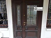 Металлические двери с ковкой и стеклом