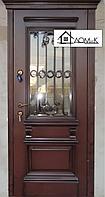 Двери железные утепленные с ковкой и стеклом