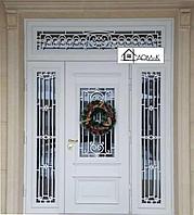 Входные железные двери с элементами ковки