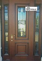 Двери со стеклом и ковкой на заказ