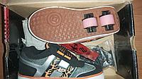 Кроссовки с двумя роликами в подошве