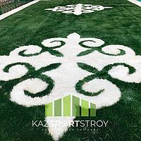 Укладка искусственного газона спортивный 4см и декоративный  с казахскими орнаментами в городе Алматы (Турксибский район) 15
