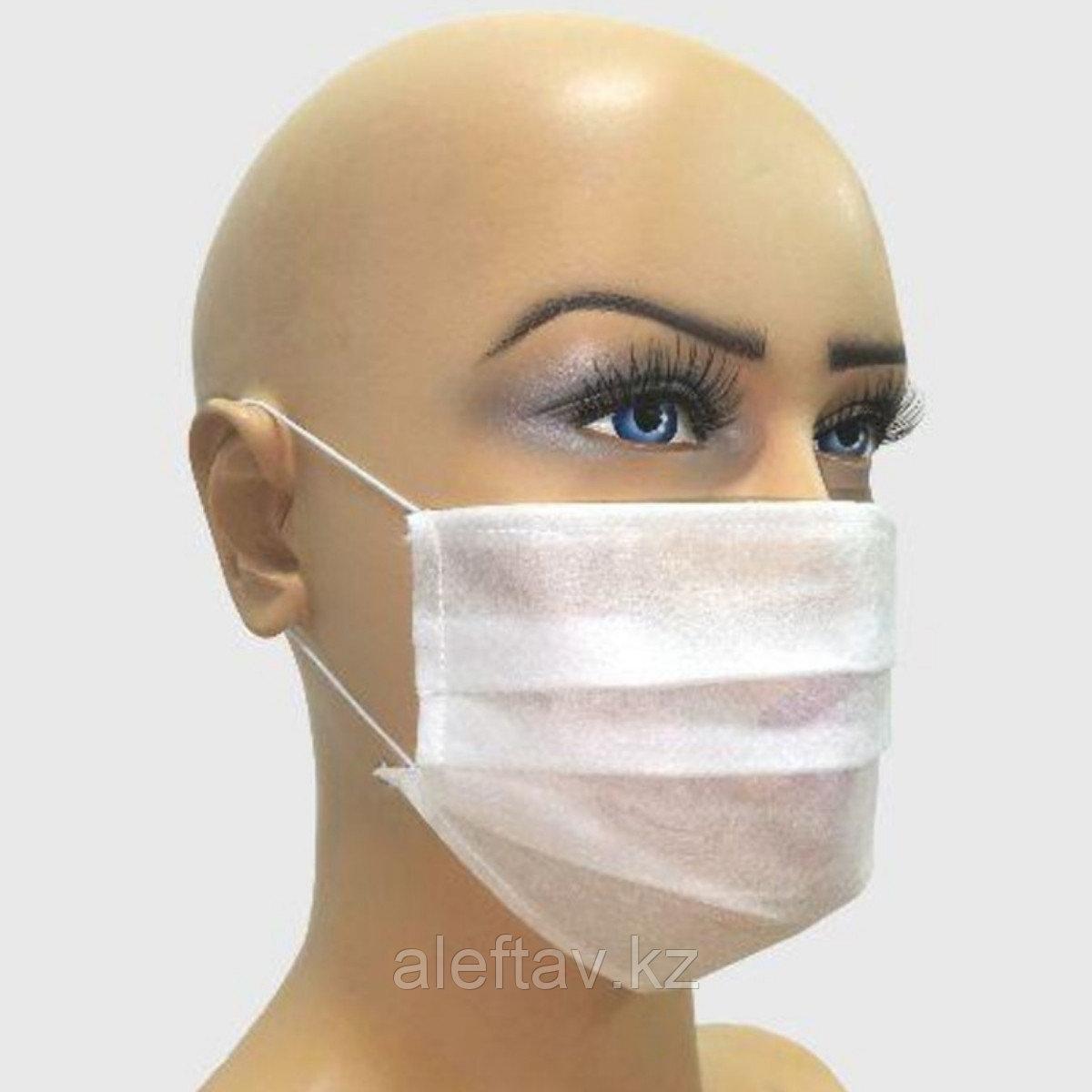 Маска медицинская одноразовая лицевая штампованная из спанбонда на резинках