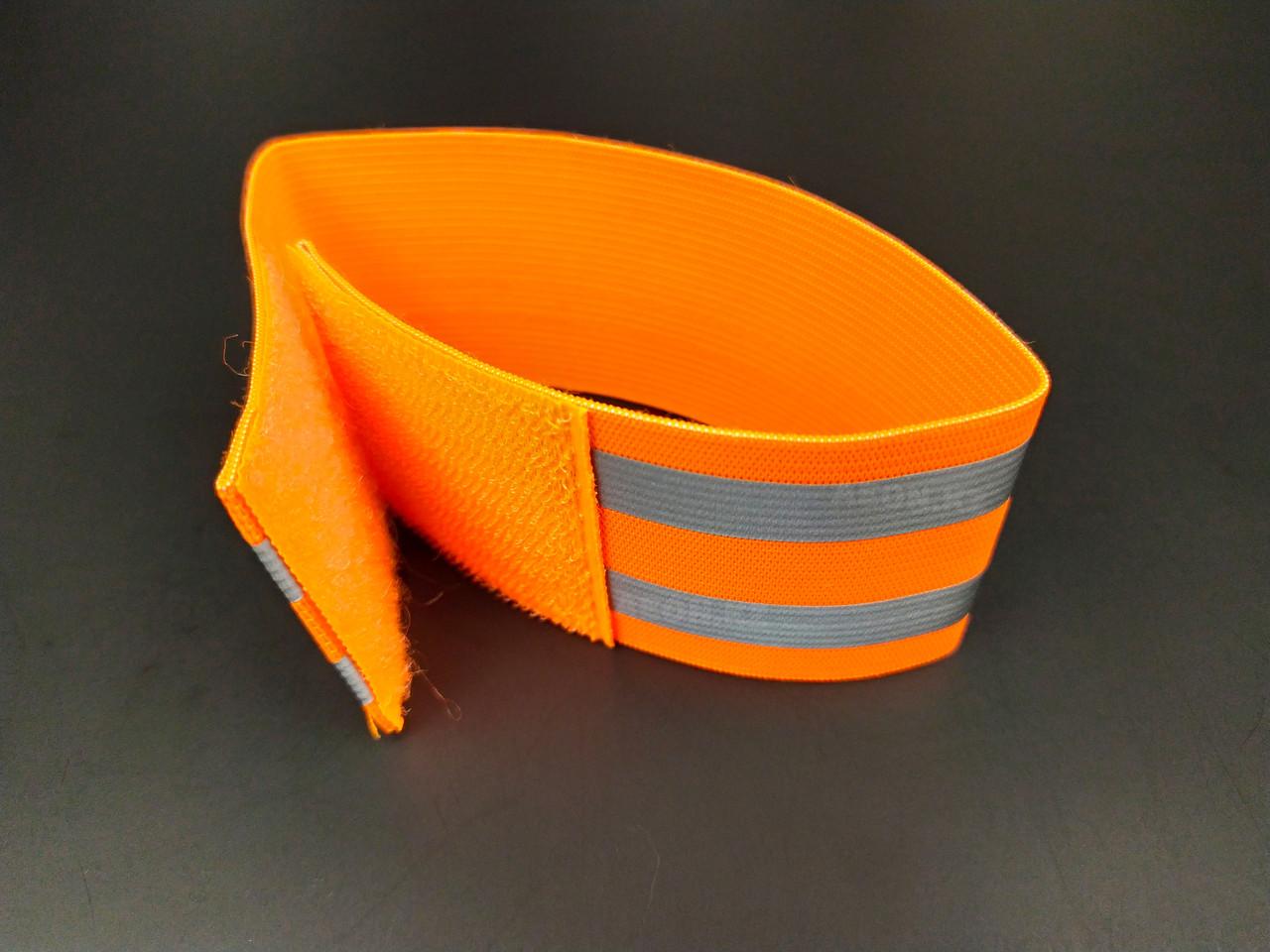Светоотражающий эластичный браслет оранжевый с двумя полосками