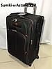 Средний дорожный чемодан на 4-х колесах Swissgear. Высота 70 см, ширина 40 см, глубина 29 см.