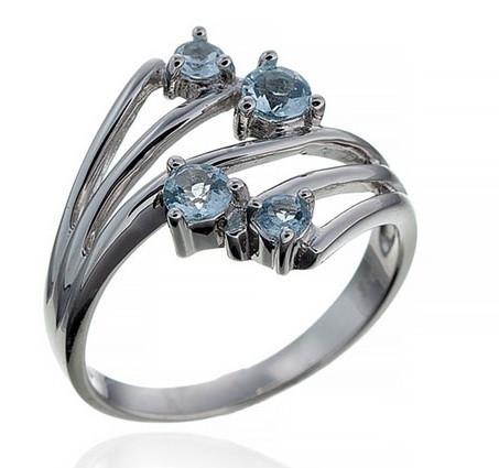 Серебряное кольцо с голубым топазом. Вес: 4 гр, размер: 19, покрытие родий