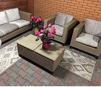 Комплект мебели из ротанга: трехместный диван, два кресла с раскладным столиком