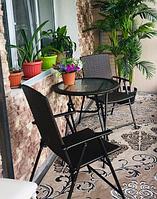 Комплект мебели из ротанга. Два легких изящных стула, стол круглый стеклянный