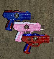 Пистолет средний музык. (20см) роз, син, красн.
