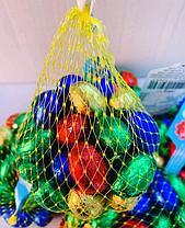 Шоколадные яйца в сетке в сетке 200 гр.