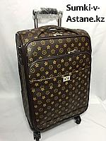 Маленький дорожный чемодан на 4-х колесах.Высота 57 см, ширина 35 см, глубина 22 см.