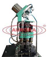 Завод АВРОРА Автоматическая машина для укупорки стеклянной тары кронен-пробками