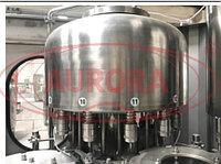 Завод АВРОРА Автоматический моноблок розлива и укупорки жидких негазированных продуктов