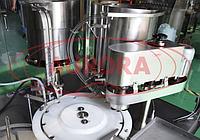 Завод АВРОРА Автоматическая линия для забивки резиновых пробок и завальцовки алюминиевых колпачков