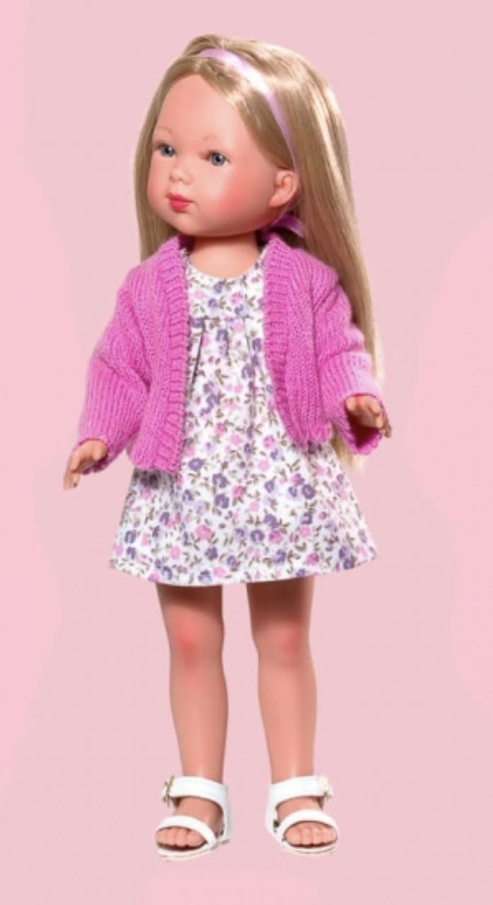 Карлота  в платье с принтом и розовом кардигане