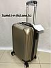 Маленький пластиковый дорожный чемодан на 4-х колесах.Высота 53 см, ширина 33 см, глубина 22 см.