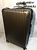 """Большой пластиковый дорожный чемодан на 4-х колесах""""Longstar"""".Высота 74 см, ширина 46 см, глубина 27 см."""