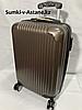 Маленький пластиковый дорожный чемодан на 4-х колесах.Высота 53 см, ширина 35 см, глубина 25 см.