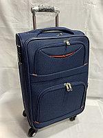 Маленький тканевый дорожный чемодан на 4-х колесах.Высота 57 см, ширина 35 см, глубина 22 см.