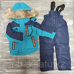 Комбинезон голубой с синими рукавами,оранжевые элементы на карманах