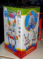 Развивающая игрушка, музыкальный кролик со звуковым и световым сопровождением., фото 1