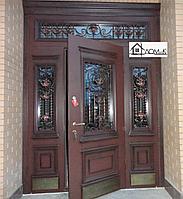 Двери железные на заказ с ковкой и стеклом